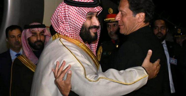 Pakistani Prime Minister Imran Khan greets Saudi Arabia's Crown Prince Mohammed bin Salman on his arrival at Pakistan Air Force Nur Khan Base in Rawalpindi